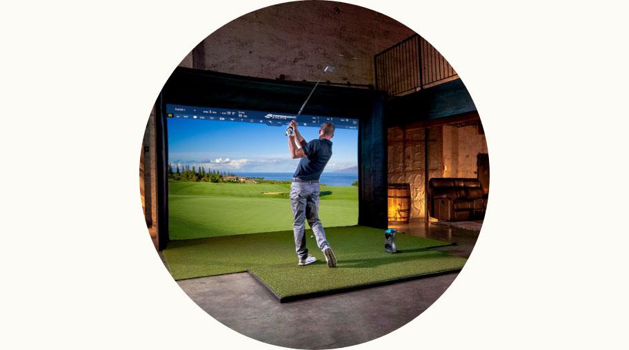 Person in golfing simulator
