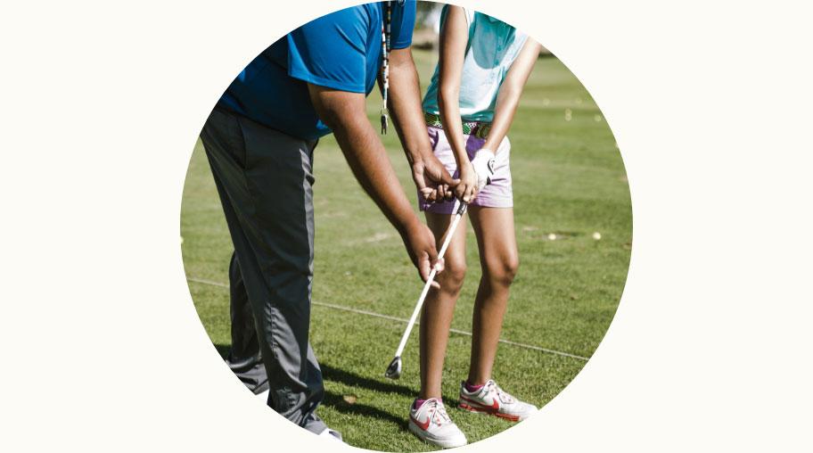 PGA Pro coaching a kid